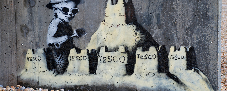Banksy work on sea wall